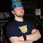 In Portland now, Graham models the Amtrak hat backstage
