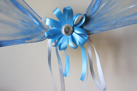 Quick and easy fairy wings tallys treasury 11 attach your flower by tying the long pieces of ribbon over the duct taped center bit of your wings let the extra ribbon hang down mightylinksfo