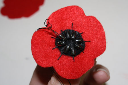 Felt poppies for remembrance day tallys treasury 4 using your red thread now take the larger red flower and sew a rough circle of large stitches around its centre mightylinksfo