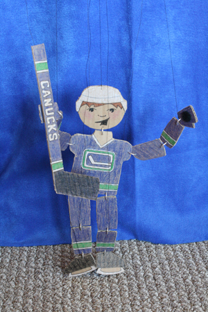 recycling paper: cardboard marionettes – go canucks!